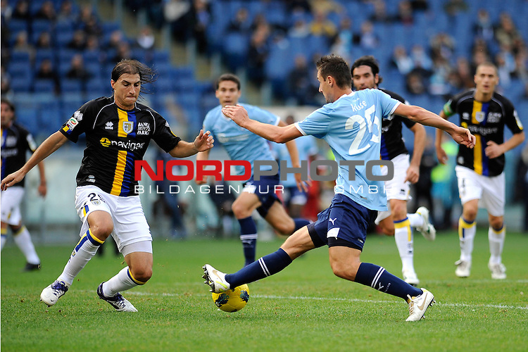 Miroslav KLOSE (Lazio) fights for the ball possession against Gabriel PALETTA (Parma). ROMA 06/11/2011, Stadio Olimpico, Calcio, Campionato di Serie A 2011/2012, Lazio Vs Parma.<br /> Foto &copy; nph /  sportmedia<br /> ***** Attention only for GER, CRO, SUI *****