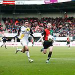Nederland, Nijmegen, 2 december 2012.Eredivisie .Seizoen 2012-2013.N.E.C.-NAC Breda.Eric Botteghin (l.) van NAC Breda en Melvin Platje (r.) van N.E.C. strijden om de bal.