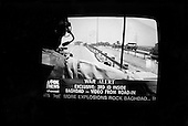 USA.2003..TV images of embedded FOX news reporters entering Baghdad with US troops.