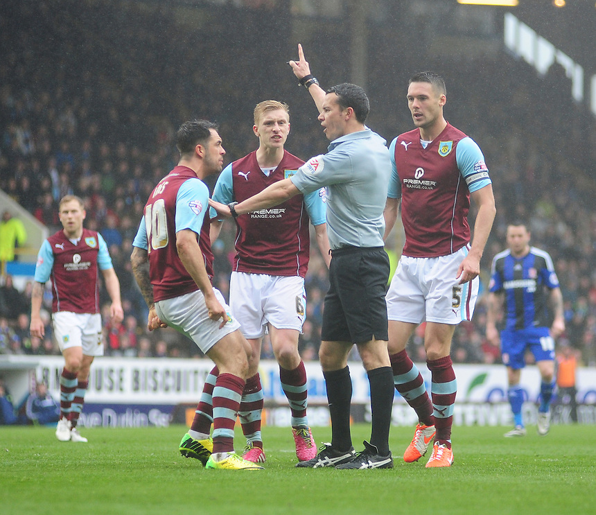 Burnley's Danny Ings, left, complains to Referee Dean Whitestone as a decision goes against him<br /> <br /> Photo by Chris Vaughan/CameraSport<br /> <br /> Football - The Football League Sky Bet Championship - Burnley v Middlesbrough - Saturday 12th April 2014 - Turf Moor - Burnley<br /> <br /> &copy; CameraSport - 43 Linden Ave. Countesthorpe. Leicester. England. LE8 5PG - Tel: +44 (0) 116 277 4147 - admin@camerasport.com - www.camerasport.com