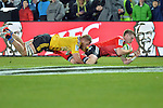 NELSON, NEW ZEALAND - MAY 29: Mitchell Drummond of the Crusaders scores a try in the tackle of Brad Shields of the Hurricanes during the round 16 Super Rugby match between the Crusaders and the Hurricanes at Trafalgar Park on May 29, 2015 in Nelson, New Zealand.. (Photo Barry Whitnall/Shuttersport Limited