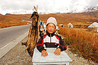 Boys selling pork skin on the road to the mountains, Kyrgyzstan Few years ago photographers Anthony Asael and Stepahnie Rabemiafara dreamed a dream that seemed quite imposible: to visit every country of the World promoting arts and tolerance among children and, of course, taking photographs of them. With little money and resources but an impressing will, the duo got an astonishing goal. In four years they visited 300 schools in 192 countries where kids participating of the project created 18,000 pieces of artwork. <br />