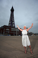 COPY BY TOM BEDFORD<br /> Pictured: Pat Stewart infront of Blackpool Tower.<br /> Re: A pin-up girl from the 1950s has returned to the spot where she accidentally flashed her knickers and won the nation's hearts.<br /> Pat Stewart was a teenage dancer when she and a pal were persuaded to pose for a picture on Blackpool seafront.<br /> As the camera clicked a gust of wind lifted her skirt to give just a glimpse of forbidden flesh.<br /> Pat became known as the girl in the spotty dress and it helped kick-off her showbusiness career.<br /> And 65 years later Pat posed on the same spot after returning to Blackpool for the first time since the saucy snap was taken.£150 MINIMUM FOR NEWSPAPER USE PLEASE