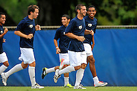 2 October 2011:  FIU's team (pictured, Nicholas Chase (8), Colby Burdette (2)) warm up prior to the match.  The FIU Golden Panthers defeated the University of Kentucky Wildcats, 1-0 in overtime, at University Park Stadium in Miami, Florida.