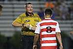 30 August 2013: Referee John McCloskey shows a yellow card to Rutger's Nathan Bruccoleri (8). The Duke University Blue Devils hosted the Rutgers University Scarlet Knights at Koskinen Stadium in Durham, NC in a 2013 NCAA Division I Men's Soccer match. The game ended in a 1-1 tie after two overtimes.