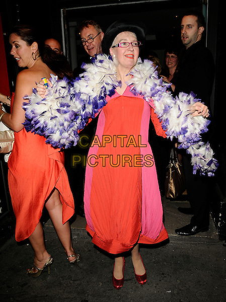 "CLAIRE SWEENEY & SU POLLARD.The ""Shout!"" press night, the Arts theatre, London, England..April 29th, 2009.full length red orange strapless dress gold peep toe strap mary janes shoes clare sweeny pink white feather boa glasses hat .CAP/CAN.©Can Nguyen/Capital Pictures."