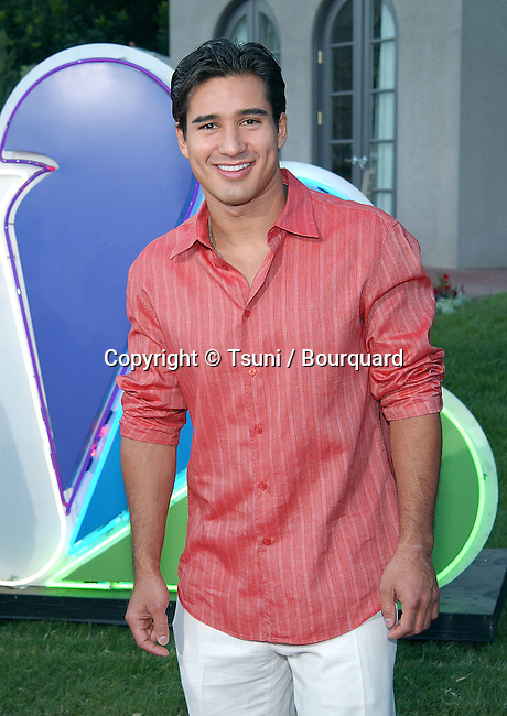 Mario Lopez (The Other Half) arriving at the All-Star Party for the new season of NBC at the Ritz Carlton in Pasadena, Los Angeles. July 24, 2002.           -            LopezMario_OthjerHalf10.jpg