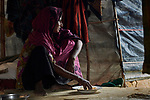Rohma Katum eats a meal inside her makeshift shelter in the Chakmarkul Refugee Camp near Cox's Bazar, Bangladesh. Katum, a Rohingya Muslim, arrived in the sprawling camp one month earlier.<br /> <br /> More than 600,000 Rohingya have fled government-sanctioned violence in Myanmar for safety in Bangladesh.