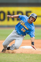 Zach Cone (12) of the Myrtle Beach Pelicans stumbles as he rounds third base during the game against the Winston-Salem Dash at BB&T Ballpark on May 7, 2014 in Winston-Salem, North Carolina.  The Pelicans defeated the Dash 5-4 in 11 innings.  (Brian Westerholt/Four Seam Images)
