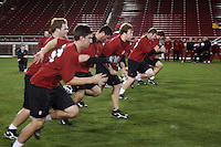 """9 February 2007: The team runs 20 yard sprints during a """"Friday Night Lights"""" practice at Stanford Stadium in Stanford, CA."""