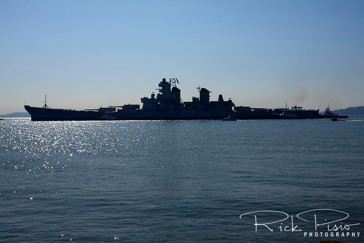 Tugboats move the battleship USS Iowa (BB61) from Benecia to Richmond, California, on October 28, 2011 after being pulled from the Mothball Fleet in Suisun Bay.