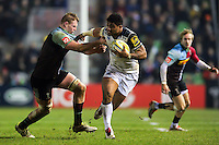 Amanaki Mafi of Bath Rugby looks to fend George Merrick of Harlequins. Aviva Premiership match, between Harlequins and Bath Rugby on March 11, 2016 at the Twickenham Stoop in London, England. Photo by: Patrick Khachfe / Onside Images