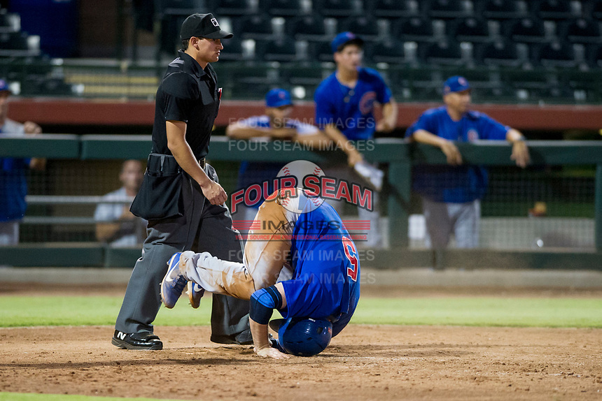 AZL Cubs catcher Marcus Mastrobuoni (5) does a reverse somersault after sliding into home plate to score a run against the AZL Giants on September 5, 2017 at Scottsdale Stadium in Scottsdale, Arizona. AZL Cubs defeated the AZL Giants 10-4 to take a 1-0 lead in the Arizona League Championship Series. (Zachary Lucy/Four Seam Images)