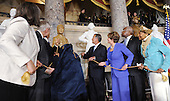 United States President Barack Obama, with guests and members of Senate and Congress including Speaker of the U.S. House John Boehner (Republican of Ohio) unveil the statue of Rosa Parks in Statuary Hall of the United States Capitol February 27, 2013 in Washington, DC. .Credit: Olivier Douliery / Pool via CNP