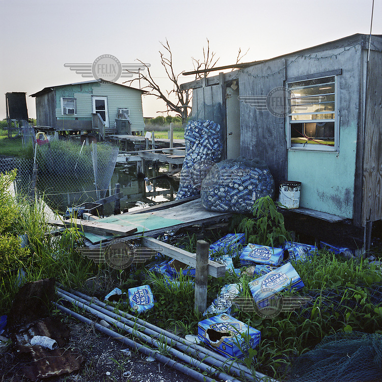 A shack where three of the Dardar brothers spend their days on Isle Jean Charles, Louisiana drinking beer and collecting the cans in shrimping nets. The brothers speak French, the language still spoken by many members of the tribe who intermingled with European settlers long before Louisiana became a state, though their Native American ancestors spoke Choctaw.
