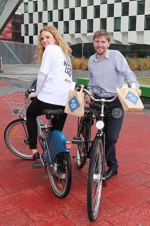 NO REPRO FEE. 8/6/2011.Dublin's Bike to Work Day. Sinead Mitchell and DCC cycling officer Ciaran Fallon are pictured at Grand Canal Dock launching Bike to Work Day, they took a spin around Dublin Docklands on Dutch bicycles to prepare for the lunchtime cycle on June 22nd, at which all workers who cycle to their place of employment will be encouraged to take part.Win one of 500 goodie bags by registering to attend the event @ www.dublincitycycling.ie.  Prizes for best dressed will also be presented following the cycle For further information contact:Emer O'Reilly, Limelight Communications E: emer.oreilly@limelight.ie T: 01 6680600 /0868593658. Picture James Horan/Collins Photos