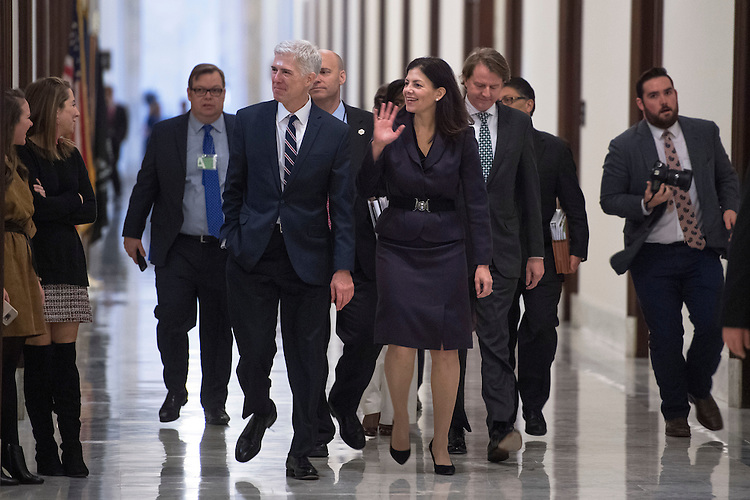 UNITED STATES - FEBRUARY 01: Supreme Court nominee Neil Gorsuch, left, and former Sen. Kelly Ayotte, R-N.H., make their way to a meeting with Sen. Cory Gardner, R-Colo., in Russell Building, February 1, 2017. (Photo By Tom Williams/CQ Roll Call)