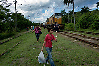 HAVANA, CUBA - OCTOBER 29: Cubans try to catch the train that travel from Havana to Matanzas on October 29, 2015 in Cuba. Ferrocarriles de Cuba, is one of the oldest railroad around world, having opened its first route in 1837 with at least 17-mile long. Now the railway probably could cover more than 2,600 miles along the Island. (Photo by Eliana Aponte/VIEWpress)