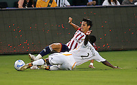 LA Galaxy defender Mike Randolph (2) and CD Chivas USA defender Alex Zotinca (23) slide for a loose ball. CD Chivas USA defeated the LA Galaxy 3-0 in the Super Classico MLS match at the Home Depot Center in Carson, California, Thursday, August 23, 2007.