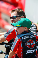 Jul 23, 2017; Morrison, CO, USA; NHRA pro stock motorcycle rider Andrew Hines with son Declan Hines during the Mile High Nationals at Bandimere Speedway. Mandatory Credit: Mark J. Rebilas-USA TODAY Sports