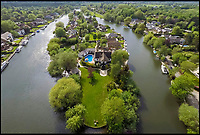BNPS.co.uk (01202 558833)<br /> Pic: JacksonStops/BNPS<br /> <br /> Jewel of the Nile - Fancy this stunning home on Pharoahs island in the Thames - gifted to Admiral Nelson after his victory at the Battle of the Nile 1798.<br /> <br /> The Edwardian property on Pharaoh's Island near Shepperton Lock which comes with its own swimming pool and guesthouse can only be accessed by boat, via an exclusive 90ft mooring. <br /> <br /> It was used for the shooting of two John Boorman films, Hope and Glory (1987), which was Academy Award nominated for Best Picture, and Queen and Country (2014). <br /> <br /> The island acquired its 'Pharaoh' name as it was gifted to Lord Nelson after he triumphed in the Battle of the Nile (1798). He used it as a fishing retreat and the island is now home to 23 glamorous properties.