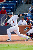 Josh Elander #24 (Texas Christian) of the USA Baseball Collegiate National Team follows through on his swing against the Japan Collegiate National Team at the Durham Bulls Athletic Park on July 3, 2011 in Durham, North Carolina.  USA defeated Japan 7-6.  (Brian Westerholt / Four Seam Images)