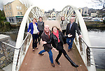 Michael Donnellan, former dancing world champion, and his pupil Clare Daly with (from left) Sharon Meaney, Clare Volunteer Centre; Tracey Crawford, Ennis Roots Music Weekend; Tess Purcell, stylist, and Brian O' Neill, president of the Ennis Chamber, during the launch of the 'Welcoming Claire To Clare' campaign at the Harmony Bridge in Ennis. Photograph by Declan Monaghan