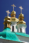 Travel stock photo of The Mother of God Christmas church golden cupola with crosses near the far caves of Kiev pechersk lavra - Cave monastery in Kiev Ukraine Eastern Europe Architecture in Ukrainian baroque architectural style Vertical May 2007