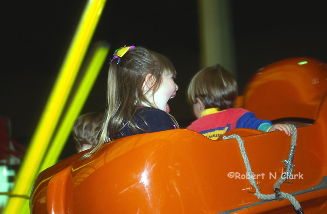 Kids on Dumbo ride at county fair