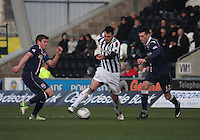 Steven Thompson being challenged by Richard Brittain (left) and Rocco Quinn in the St Mirren v Ross County Clydesdale Bank Scottish Premier League match played at St Mirren Park, Paisley on 19.1.13.