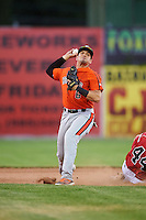 Aberdeen IronBirds second baseman Alejandro Juvier (6) throws to first as Jarett Rindfleisch (44) slides into second during a game against the Batavia Muckdogs on July 15, 2016 at Dwyer Stadium in Batavia, New York.  Aberdeen defeated Batavia 4-2.  (Mike Janes/Four Seam Images)