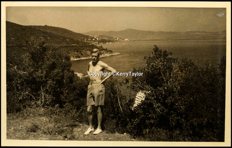 BNPS.co.uk (01202 558833)<br /> Pic: KerryTaylor/BNPS<br /> <br /> A shirtless Edward Vlll on his controversial holiday to Greece in August 1936.<br /> <br /> Never before seen private photos of King Edward VIII and his mistress Wallis Simpson on a cruise that triggered the constitutional crisis and his abdication have been discovered.<br /> <br /> The photo album of 200 holiday snaps makes up part of an extraordinary treasure trove of gifts and mementoes relating to the controversial couple that was kept by close friends of theirs.<br /> <br /> The black and white photos show them swimming in the sea and one of a bare-chested and scrawny-looking Edward posing in front of at a Greek beauty spot.<br /> <br /> The items are coming up for sale at Kerry Taylor Auctioneers in London.