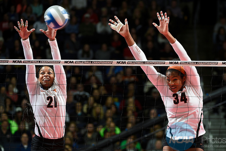 COLUMBUS, OH - DECEMBER 17:  Orie Agbaji (34) and Chloe Collins (21) of the University of Texas try for a block against Stanford University during the Division I Women's Volleyball Championship held at Nationwide Arena on December 17, 2016 in Columbus, Ohio.  Stanford defeated Texas 3-1 to win the national title. (Photo by Jamie Schwaberow/NCAA Photos via Getty Images)