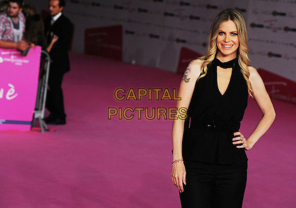 Kristin Bauer van Straten.The 'True Blood 5' photocall during the RomaFictionFest on 2012 at Auditorium Parco Della Musica, Rome, Italy. .October 3rd, 2012.half length black hand on hip tattoo.CAP/IPP/GIO.©GIO/IPP/Capital Pictures.