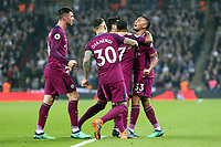 Raheem Sterling of Manchester City is congratulated after scoring the third goal during Tottenham Hotspur vs Manchester City, Premier League Football at Wembley Stadium on 14th April 2018
