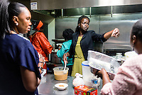 Mary Kuanen helps prepare food during a church event at the Hip Hop Church of Denver in Denver, Colorado, Saturday, October 22, 2016. Kuanen a refugee from Sudan moved to Denver 11 years ago with her husband and children. Five years ago her husband was murdered in a mistaken identity gang shooting. <br /> <br /> Photo by Matt Nager