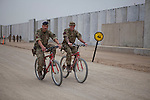 Mcc0053988 . Daily Telegraph<br /> <br /> DT News<br /> <br /> Two British soldiers cycle through Camp Bastion after the official handover ceremony of Task Force Helmand to Nato command signalling the end of British combat operations in Afghanistan .<br /> <br /> Helmand 1 April 2014