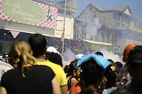 Visitors are watching explosion of tens of meters long firecrackers in the middle of people.....End of year 2010 celebrations on the streets of Paramaribo. Suriname is one of biggest consumer in South America that using firecrackers, fireworks ( also locally known as pagara ) for celebrations, especially for end of every years and also beginning of every new Chinese Years.