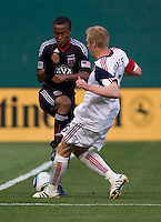 Thabiso Khumalo (17) of D.C. United collides with Nat Borchers (6) of Real Salt Lake during a U.S. Open Cup tournament game at RFK Stadium in Washington, DC.  D.C. United defeated Real Salt Lake, 2-1, in overtime.