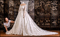 BNPS.co.uk (01202 558833)<br /> Pic: RichardCave/BlenheimPalace<br /> <br /> The stunning wedding dress worn by Camilla Thorp on her marriage to Lord George Blandford, heir to the Duke of Marlborough, has just gone on display at Blenheim Palace in Oxfordshire.<br /> <br /> The first bespoke Dolce & Gabbana bridal gown ever to have been worn in Britain, Lady Blandford made several visits to the Milan fashion house prior to her lavish September wedding last year.<br /> <br /> The dress, which is on display in the Palace's Long Library, features an off-the-shoulder lace bodice with tiny, pale pink and white appliqued flowers and seed pearls. <br /><br />The skirt is made up of layers of tulle for volume and topped with organza. Lace is also featured on the hem of the skirt and around the edge of the silk tulle veil.