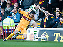 CELTIC'S ANTHONY STOKES HOLDS BACK MOTHERWELL'S TIM CLANCY
