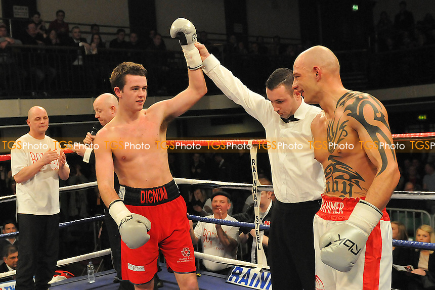 John Dignum (red shorts) defeats Kieron Gray in a Middleweight boxing contest at York Hall, Bethnal Green, London, promoted by Frank Warren - 21/03/13 - MANDATORY CREDIT: Philip Sharkey/TGSPHOTO - Self billing applies where appropriate - 0845 094 6026 - contact@tgsphoto.co.uk - NO UNPAID USE.