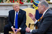 US President Donald J. Trump (L) listerns US Senate Minority Leader Chuck Schumer (R) speak during a meeting that included US House Speaker-designate Nancy Pelosi (not pictured), in the Oval Office of the White House in Washington, DC, USA, 11 December 2018. Trump, Pelosi and Schumer had a disagreement on border policy and shutting down the government.<br /> Credit: Michael Reynolds / Pool via CNP