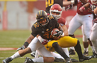 NWA Democrat-Gazette/MICHAEL WOODS • Arkansas defensive lineman Tevin Beanum tackles Missouri running back Russell Hansbrough for a loss in the 1st quarter of Friday's game at Razorback Stadium November 27, 2015.