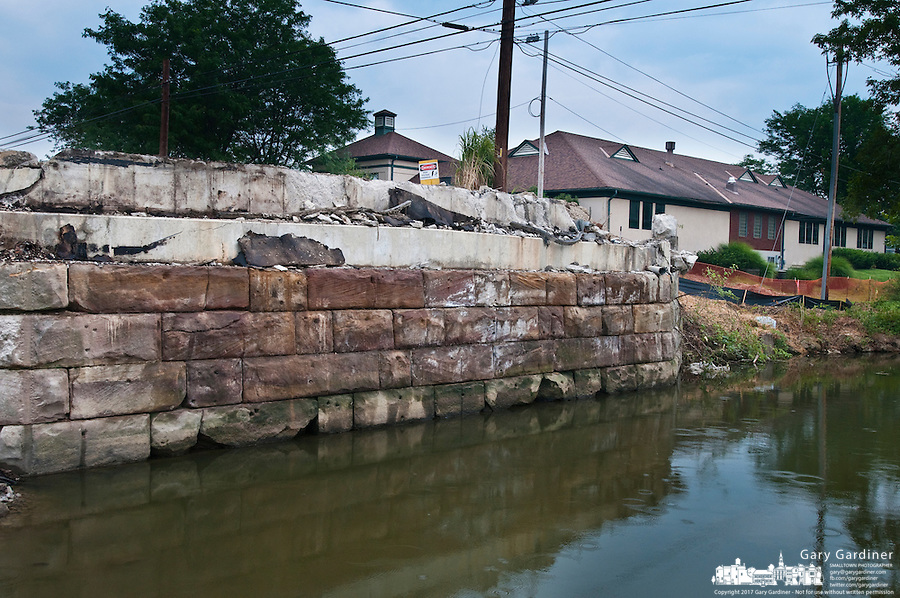 The Main Street Bridge in Westerville, Ohio, is demolished exposing the original sandstone and center abutments.