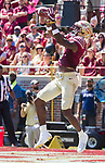 Florida State wide receiver Auden Tate catches a touchdown pass in the first half of an NCAA college football game against North Carolina State in Tallahassee, Fla., Saturday, Sept. 23, 2017.  (AP Photo/Mark Wallheiser)