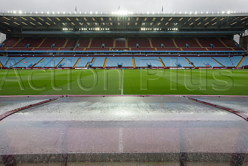 02.04.2016. Villa Park, Birmingham, England. Barclays Premier League. Aston Villa versus Chelsea.  View of the pitch and stands from behind the team dug outs highlighting the rain before the game.