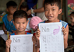 Boys show off their class work featuring the letter N in a preschool sponsored by the Kapatiran-Kaunlaran Foundation (KKFI) in Pulilan, a village in Bulacan, Philippines.<br /> <br /> KKFI is supported by United Methodist Women.