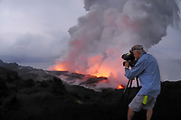 Sunrise, Videographer, lava flow at the Waikupanaha ocean entry, Hawaii, Big Island of Hawaii