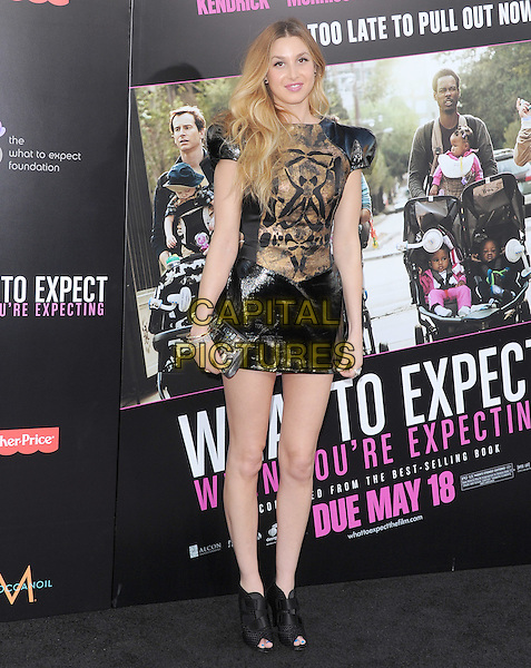 Whitney Port.Ther L.A. Premiere of  'What to Expect When You're Expecting' held at The Grauman's Chinese Theatre in Hollywood, California, USA..May 14th, 2012.full length black gold leather dress shoulder pads peep toe ankle boots shoes clutch bag.CAP/RKE/DVS.©DVS/RockinExposures/Capital Pictures.